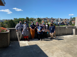 Group photo of the KaBloom judges in front of a view of Brookline